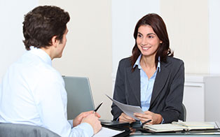A recruiter interviewing a businessman